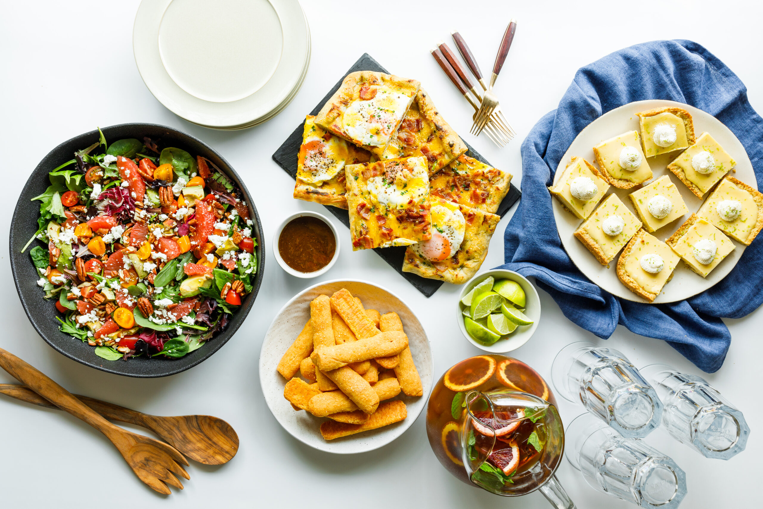a spread of appetizers and snacks that could be used for a book club