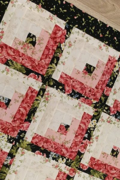 baby quilt pink black white