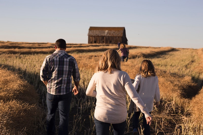 Fall Routines - A family running through a field