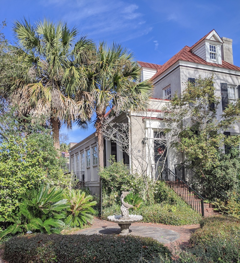 The Restoration of Celia Fairchild Inspiration found in the form of a Charleston older home with a garden and statue