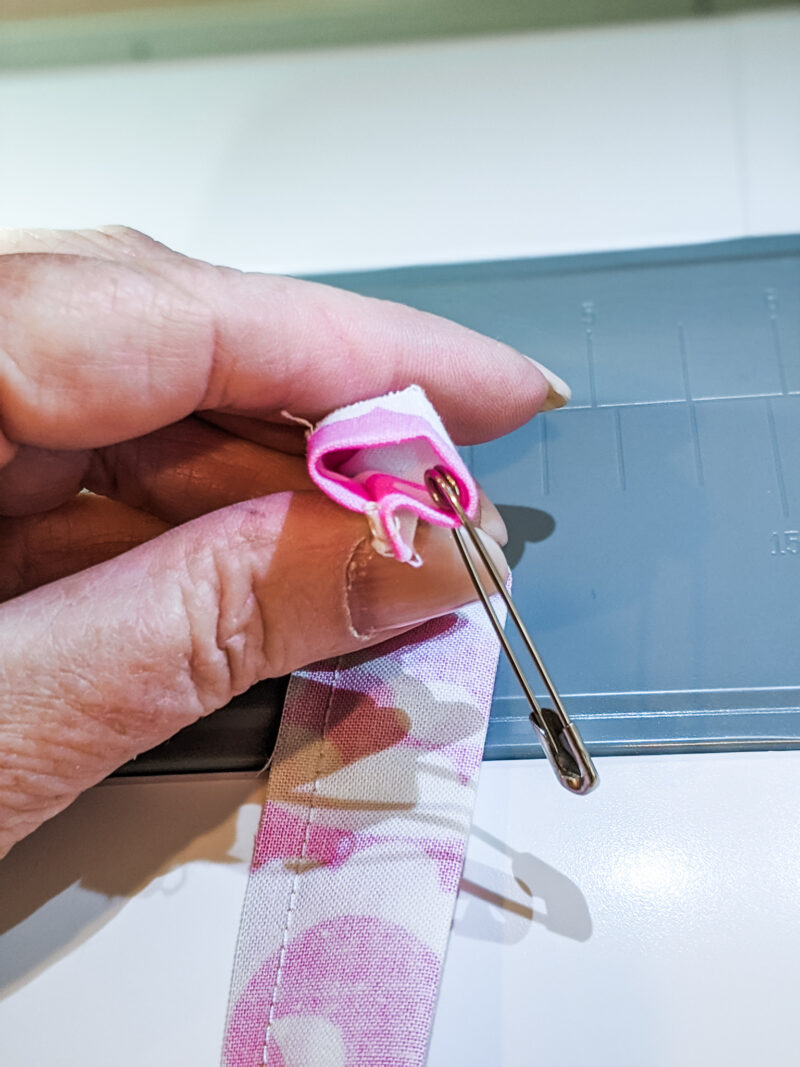 Safety pinning the strip of fabric