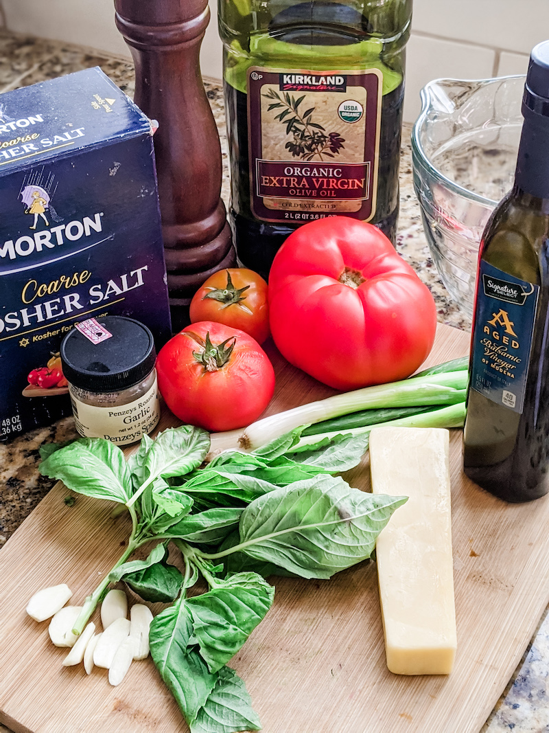 The ingredients for the tomato bruschetta laid out on a table