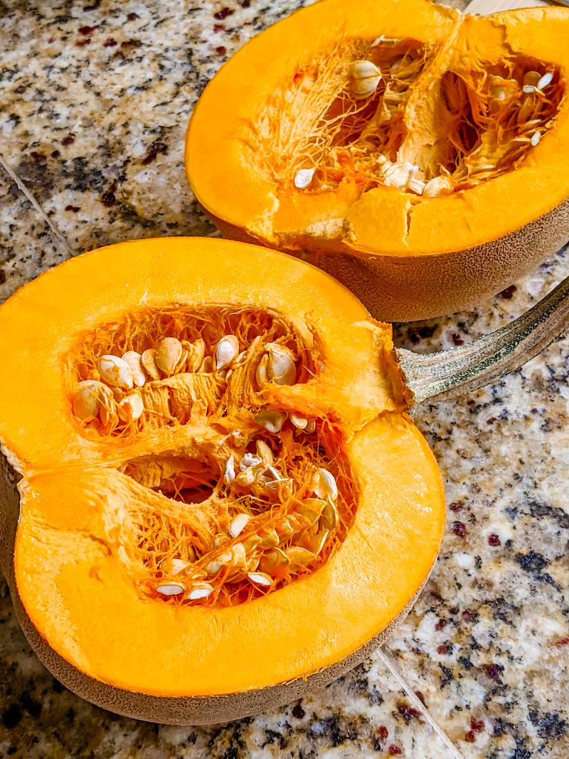 A sugar pumpkin that's been sliced in half