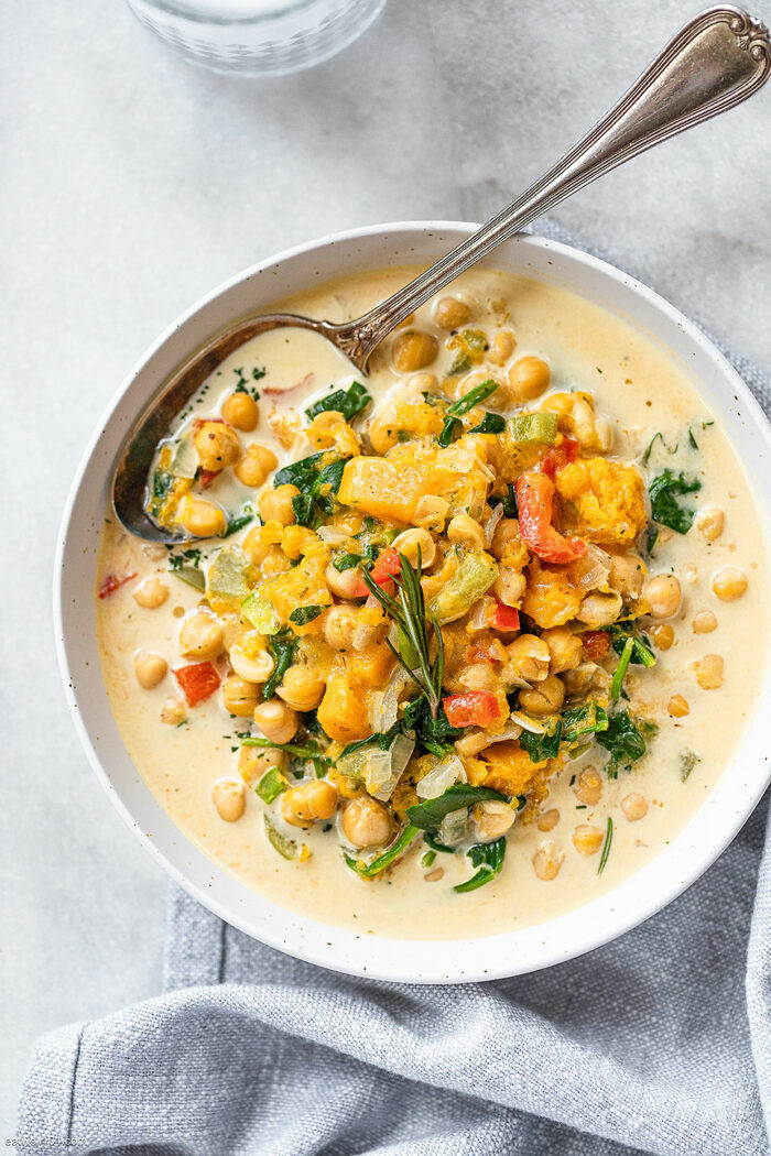 One of the Crocktober Recipe Round-Up dishes - chickpea stew in a bowl garnished with fresh herbs