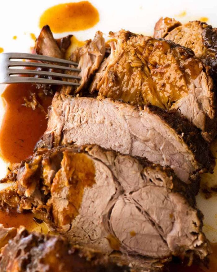 The pork loin sliced and topped with gravy