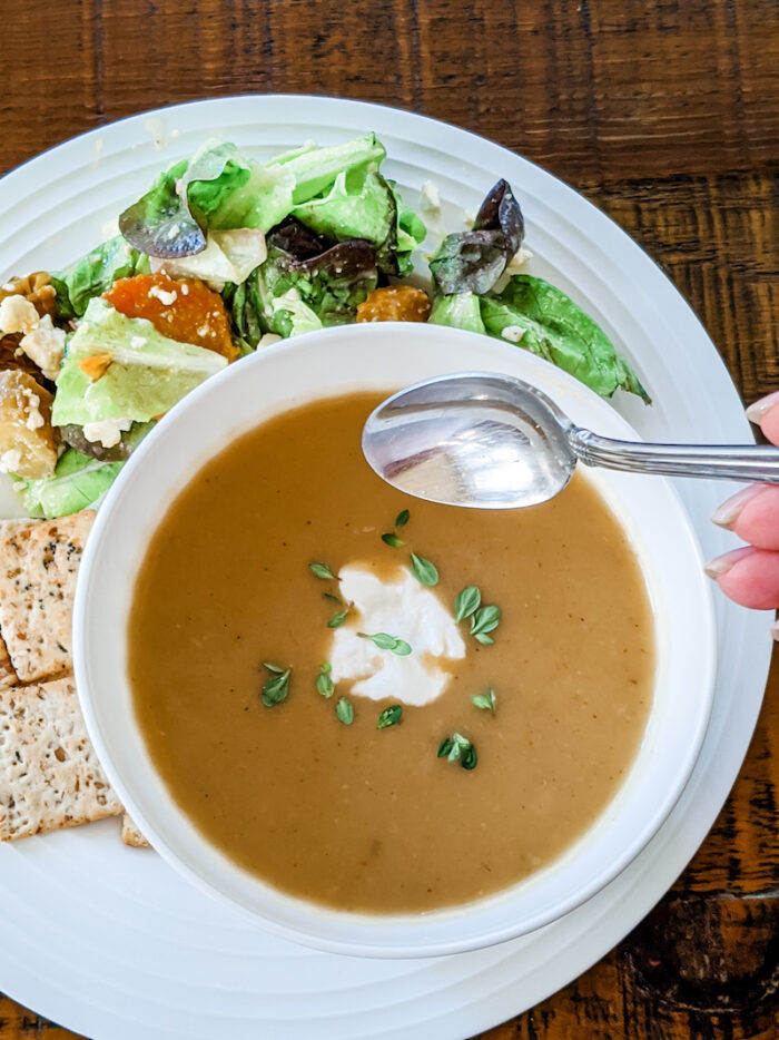 Crocktober Recipe Round-up - the zucchini soup in a bowl with a dollop of sour cream