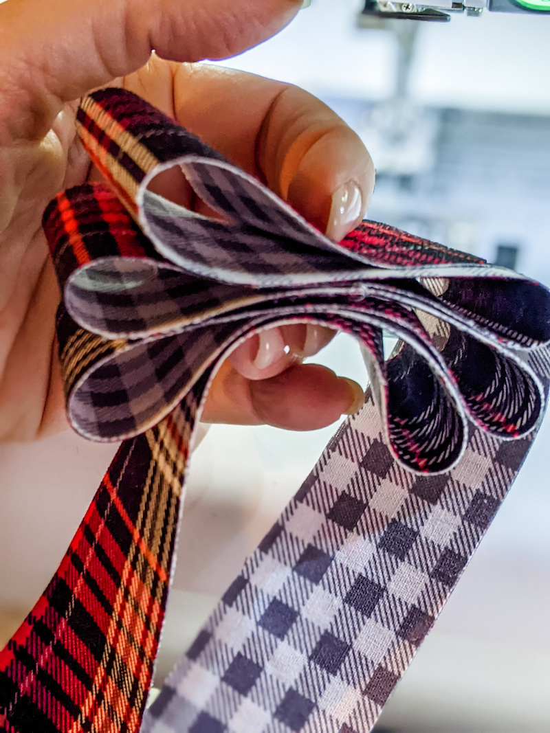 Creating the 'candy' ribbons by looping the fabric.