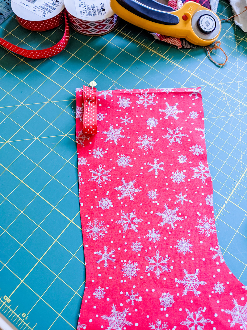 The pinned loop on the front of the Easy DIY Patchwork Christmas Stocking