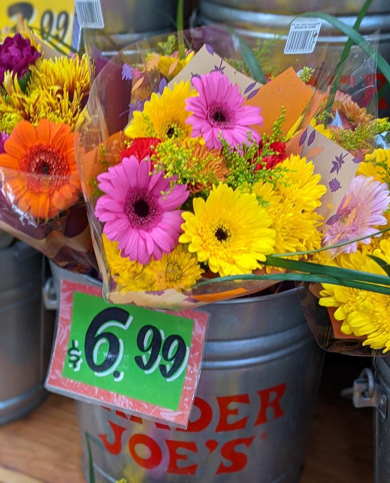 Bouquets of flowers in a metal bucket