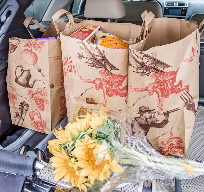 Trader Joe's Winter Favorites, bagged and loaded into a car trunk.