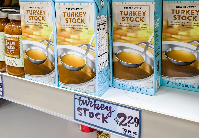 Several boxes of turkey stock on a shelf.