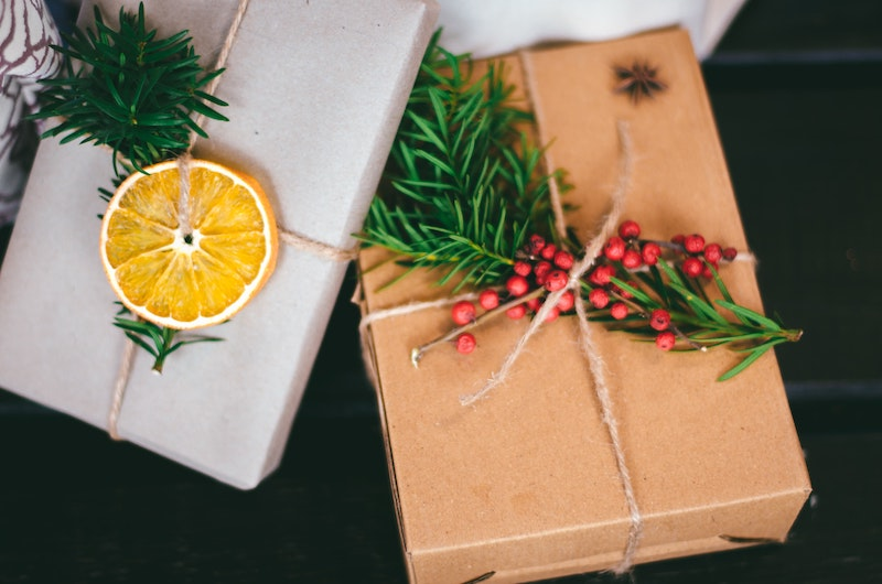 Two presents wrapped in paper and with flowery ornaments.