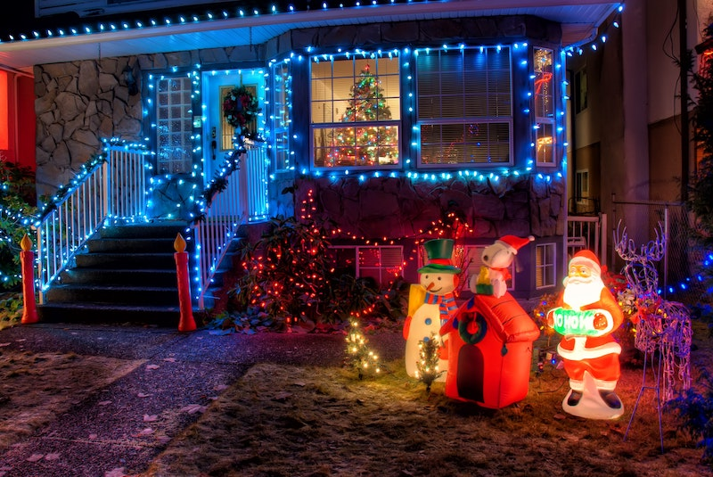 A house with outdoor Christmas decor and lights - a great tradition for Celebrate Christmas from Home