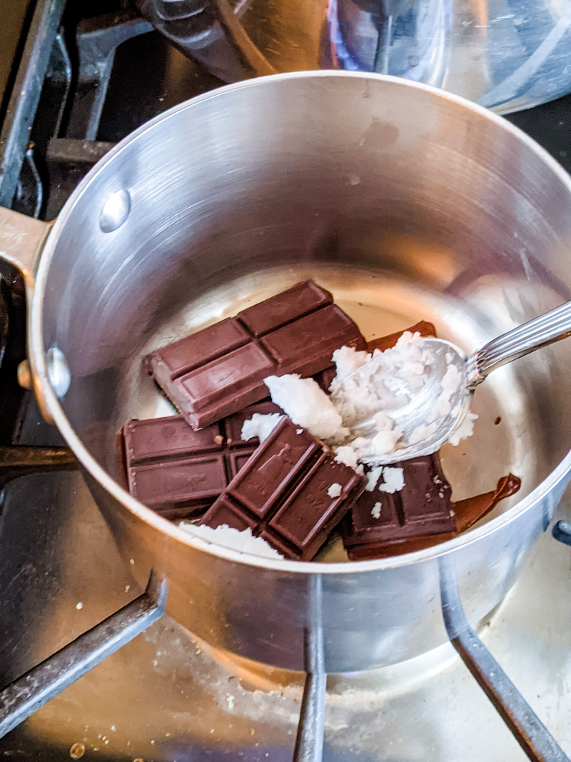 Peppermint and chocolate being mixed in a double-boiler