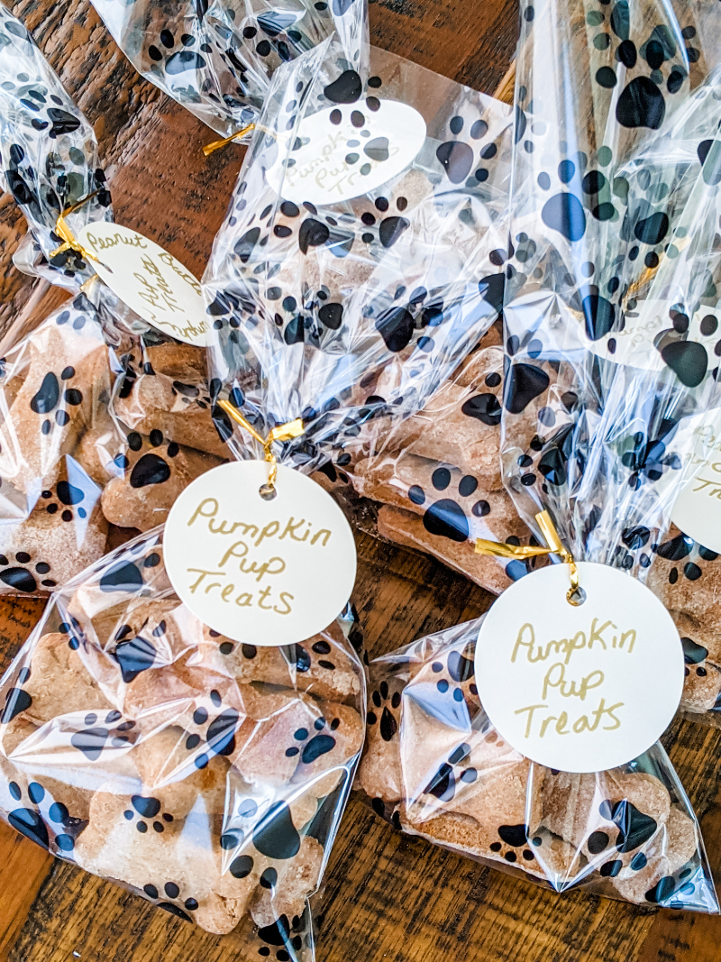 Several paw-printed bags with the homemade Pumpkin Dog Biscuits.