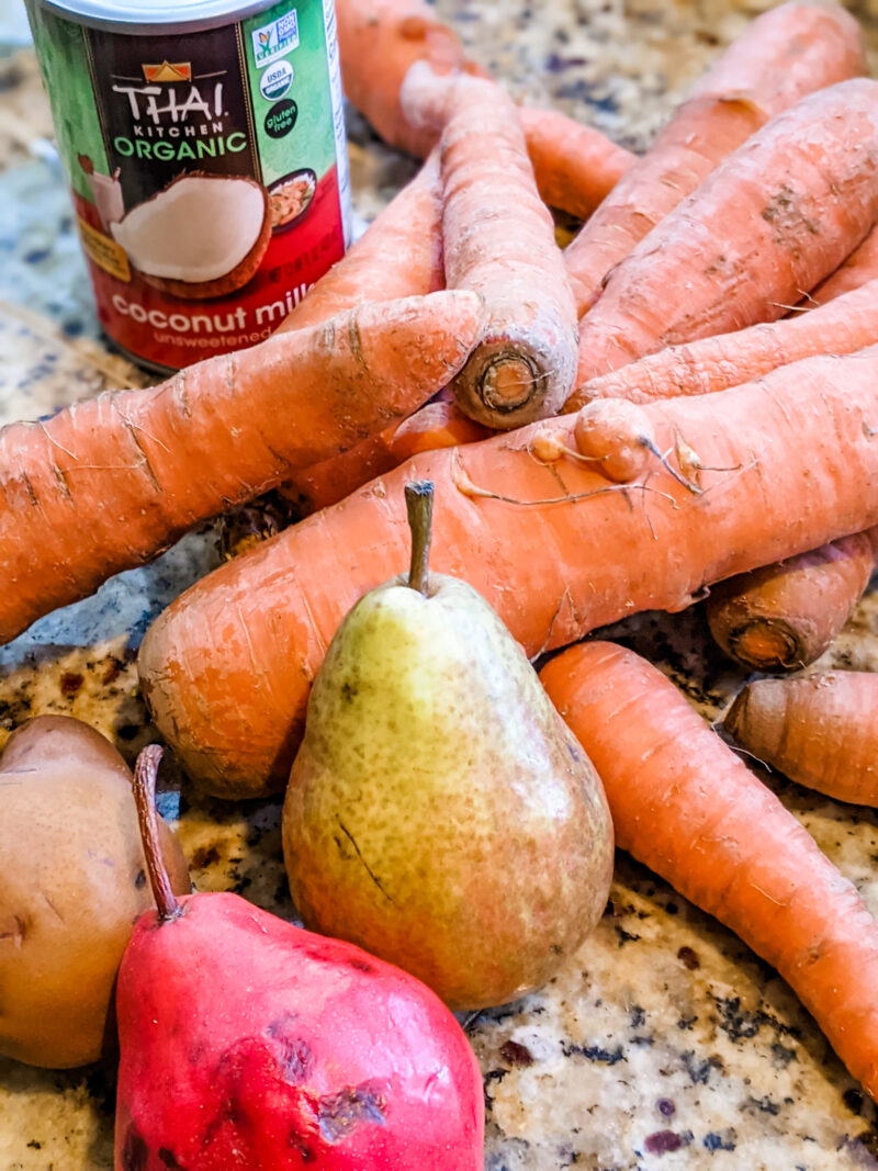 The main ingredients for the Carrot Pear Soup - coconut milk, pears, and carrots.