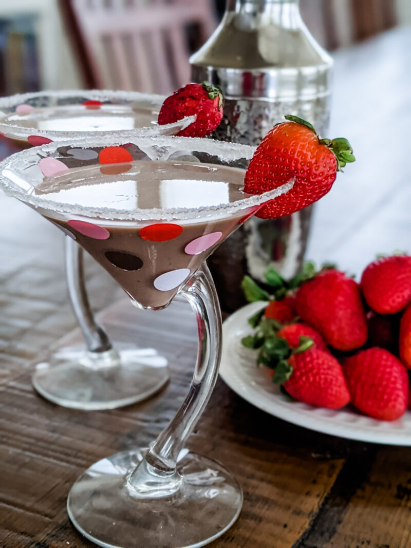 The Chocolate Martini Cocktail in two glasses. topped with strawberries