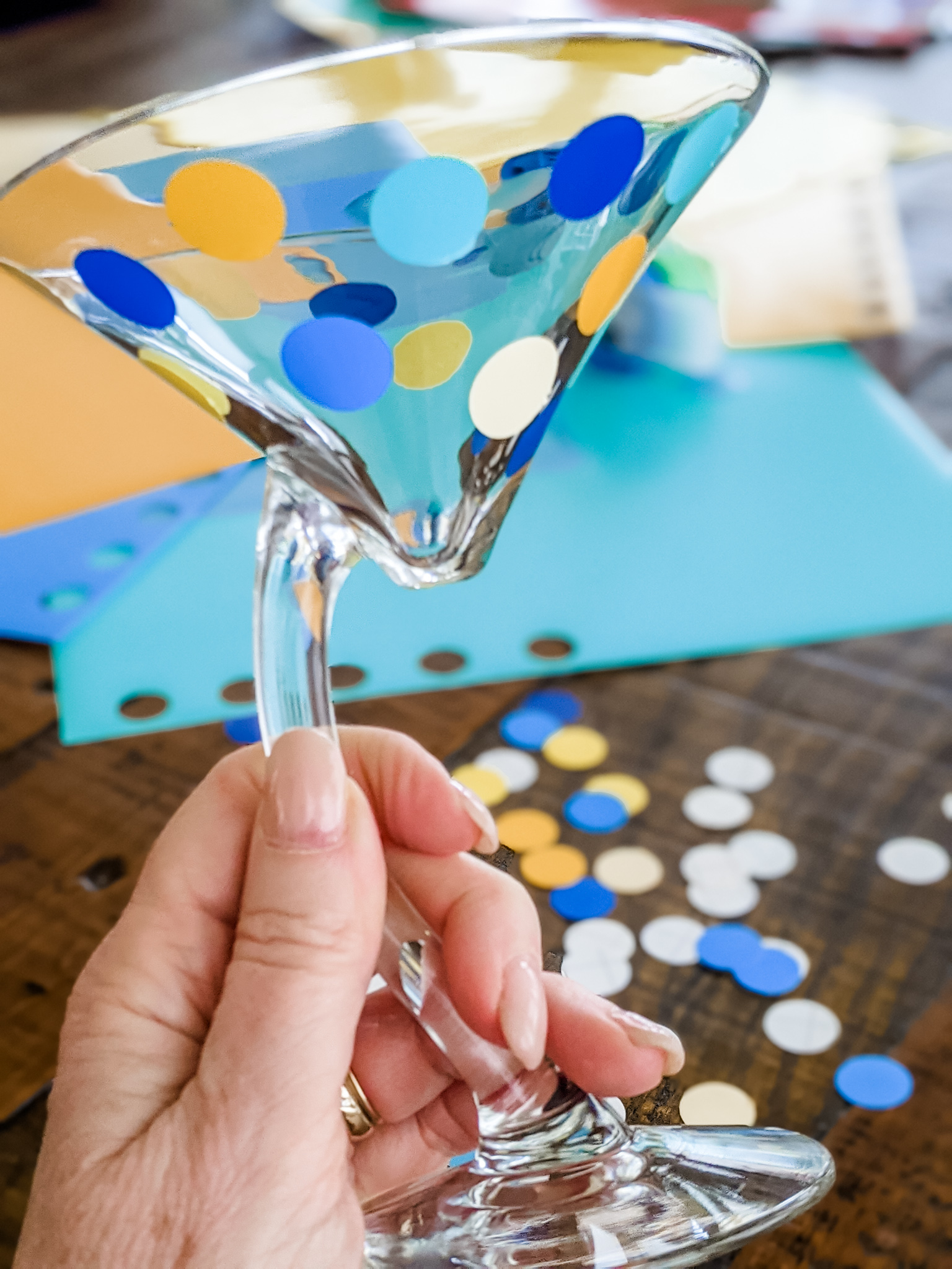 Marie placing the polka dots on the cup of the martini glass
