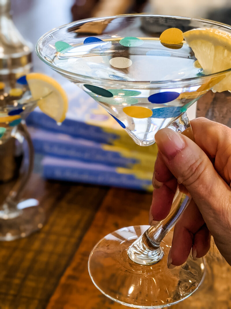 Marie's hand holding one of the DIY Polka Dot Martini Glasses