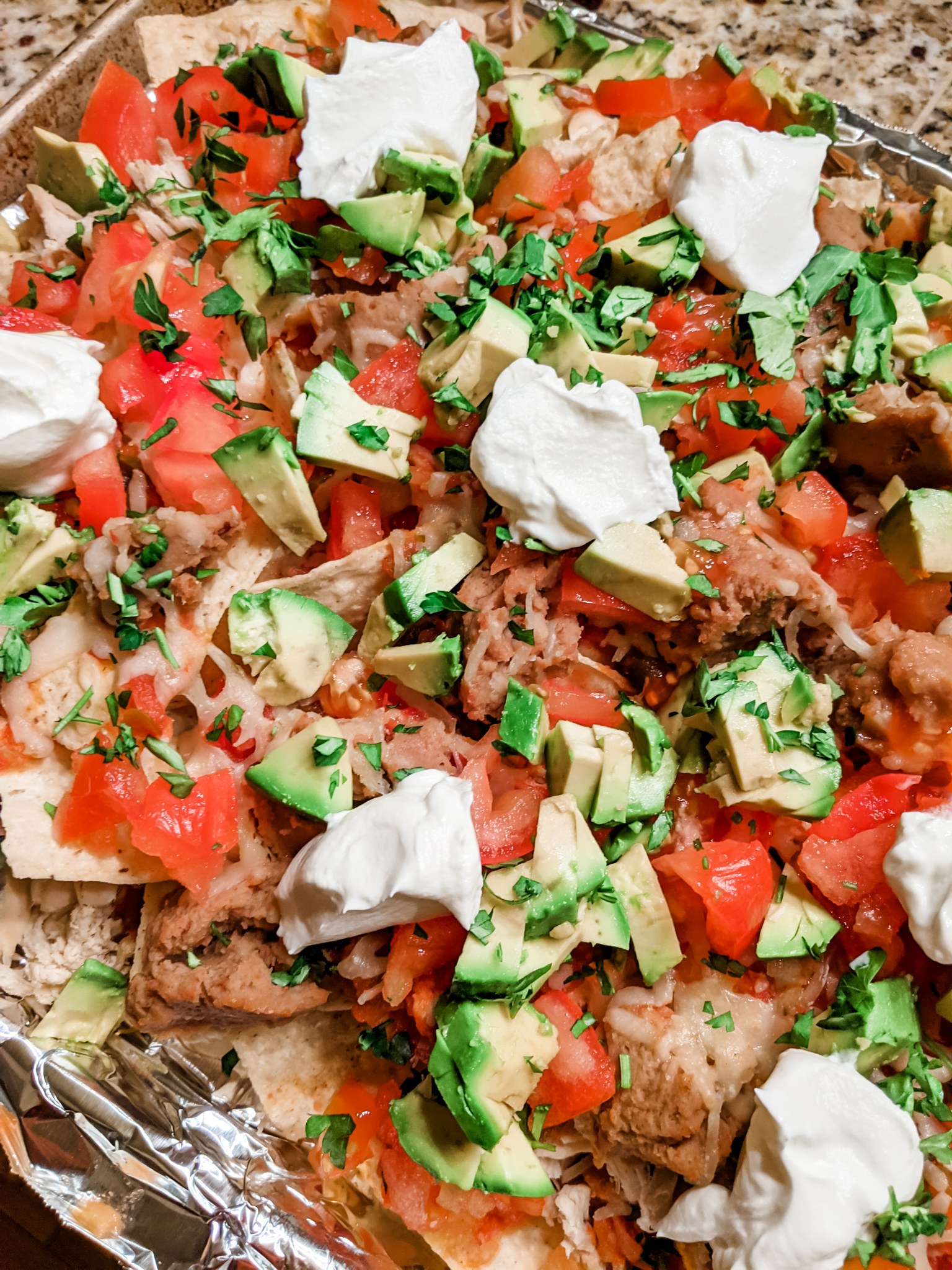 A tray full of the chicken nachos.