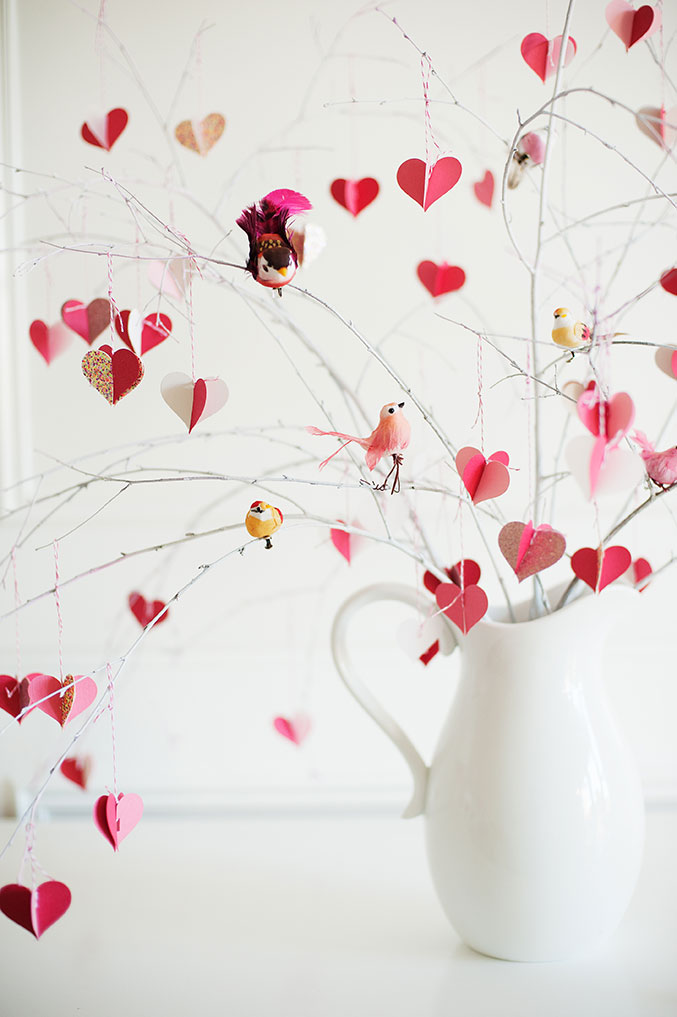 Branches decorated with hearts and birds emerging from a vase - a valentine craft