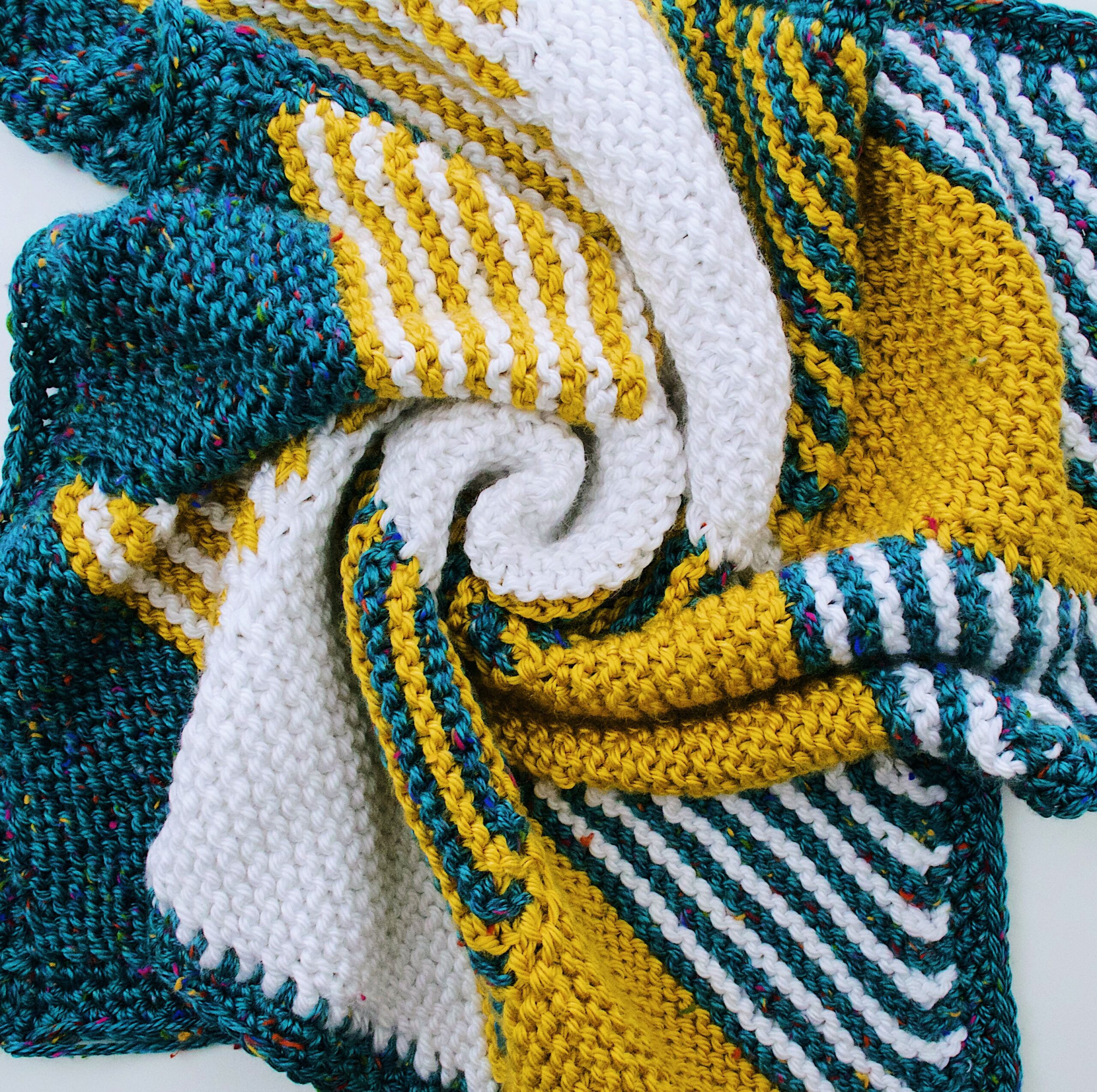 The Knitted Baby Blanket swirled together