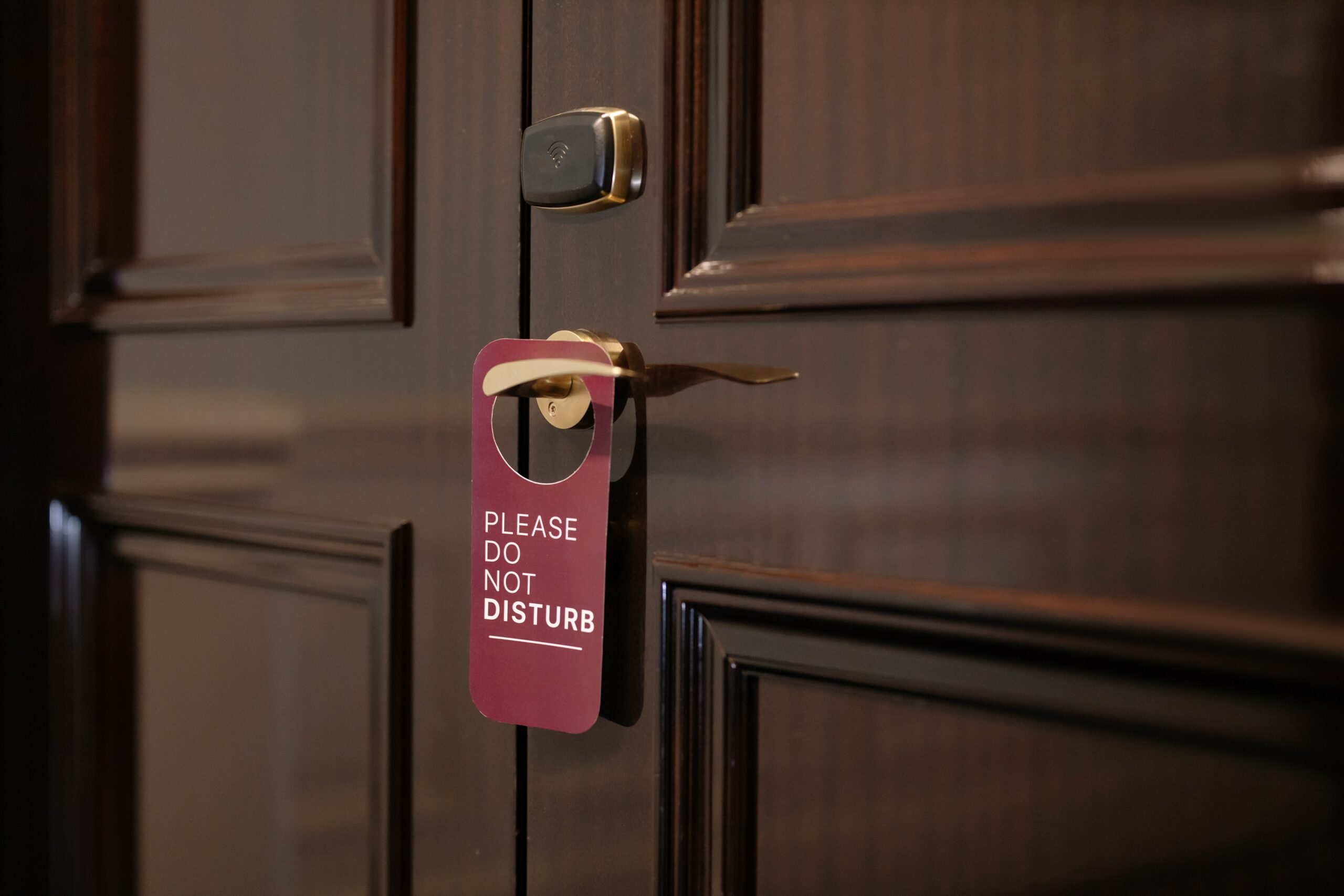A door with a Do Not Disturb sign on it