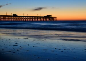 A picture of a dock along the Lowland/South Carolina shoreline at sunset