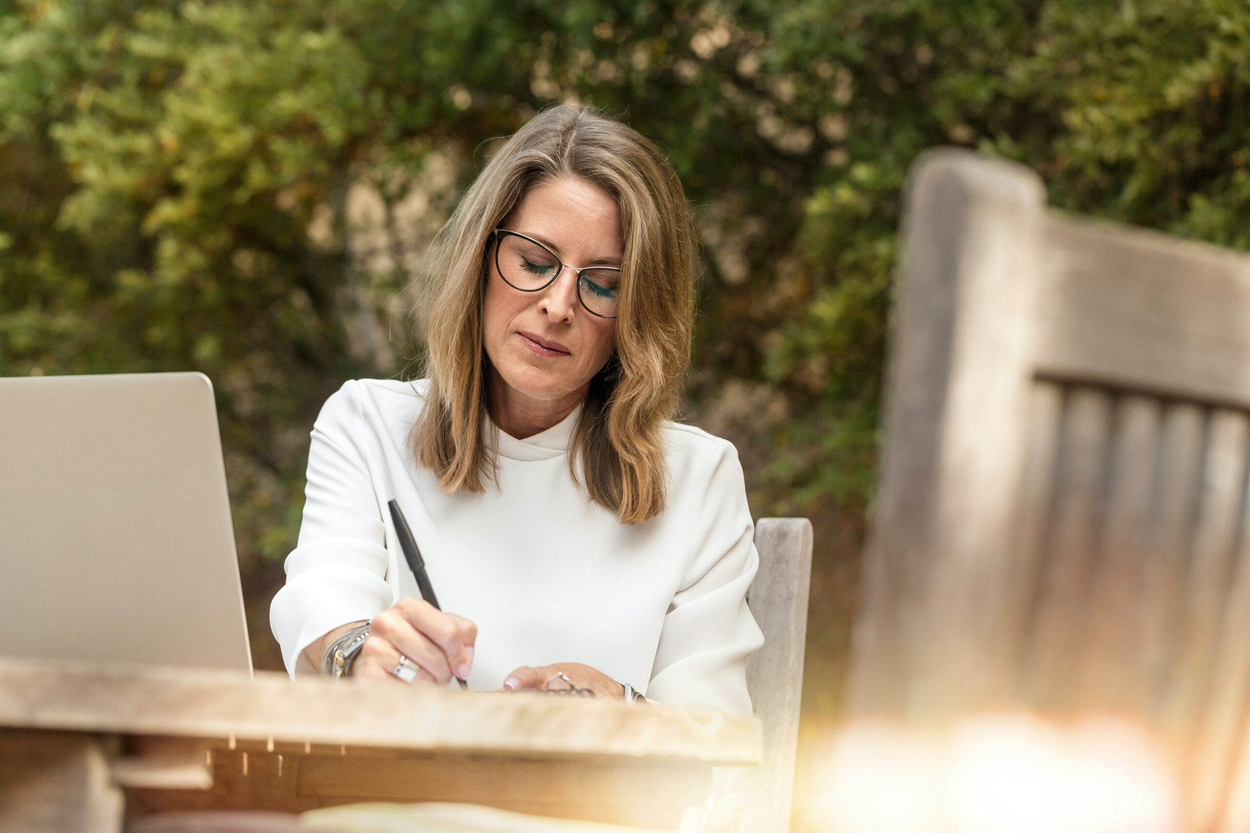 Travel Safety Tips: A woman sits at a desk writing
