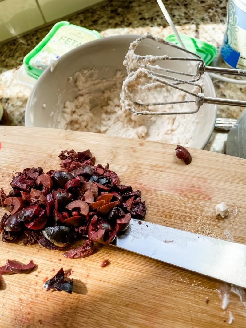 The chopped kalamata olives on a cutting board.