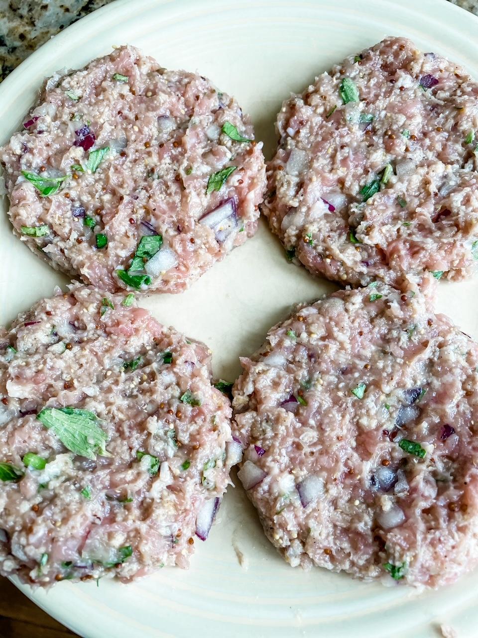 4 Chicken Rueben Burgers patties on a plate