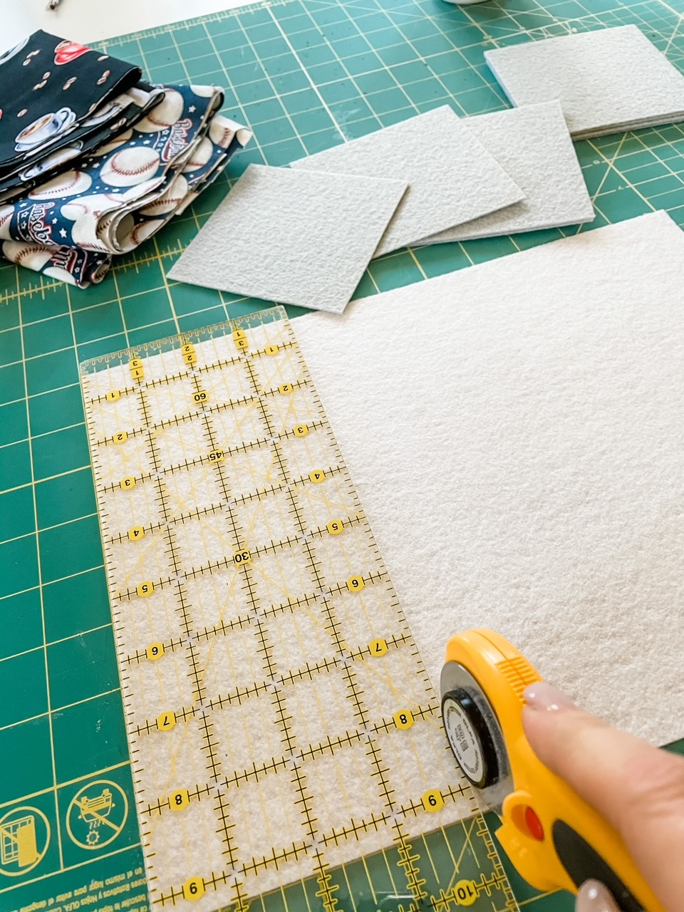 Marie measuring and cutting the fabric for the easy no sew craft coasters