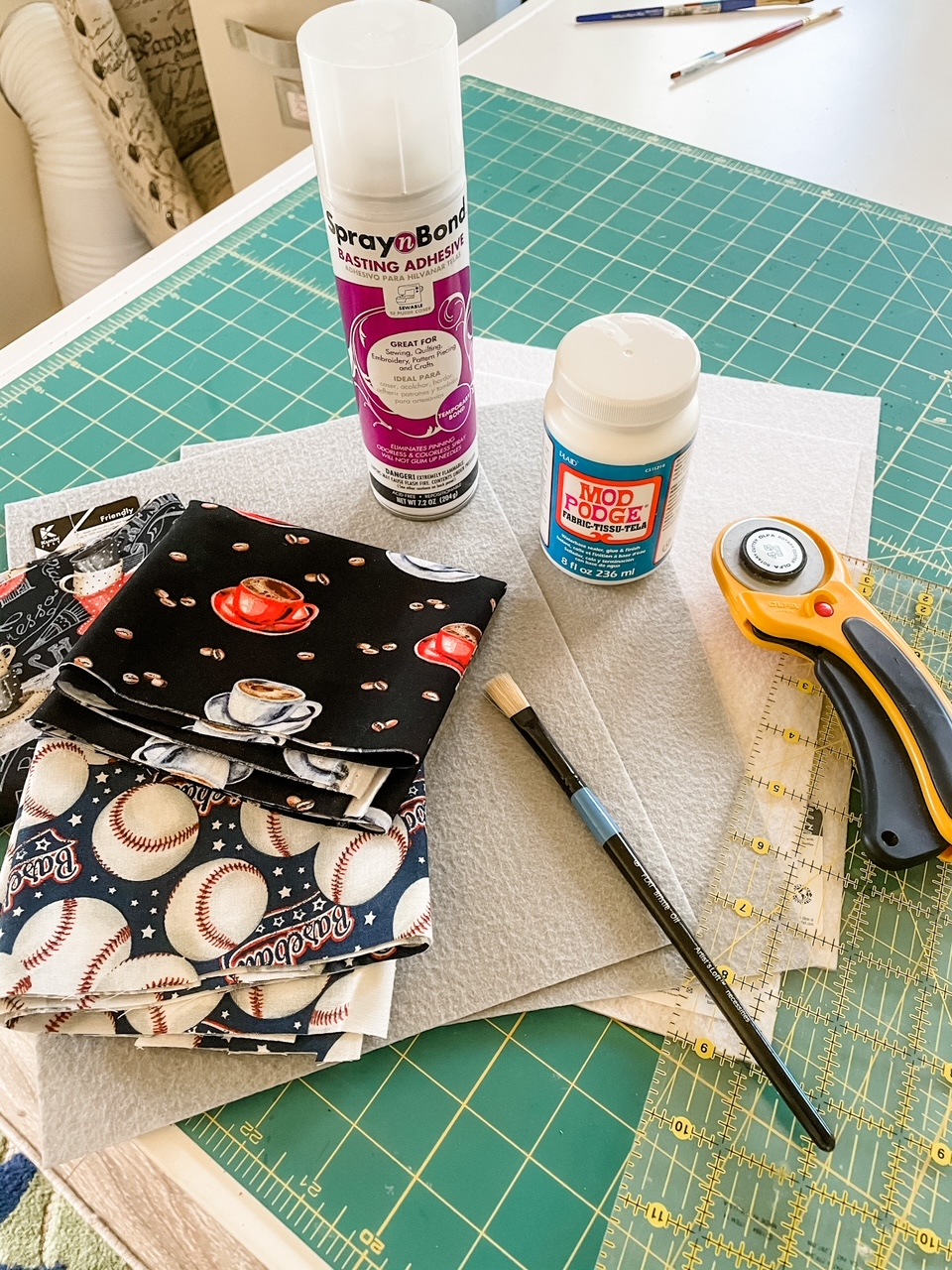 The materials for making the coasters nestled on top of a measuring pad
