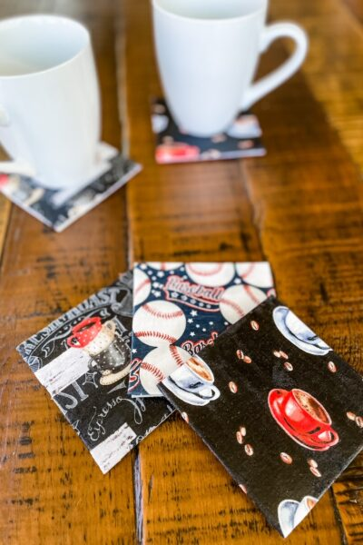 The easy no swe craft coasters - one with coffee, one with baseballs, and one with an abstract print