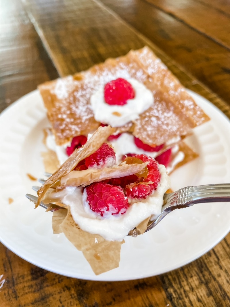 A fork taking a piece from the Raspberry Napoleons – A Healthy Dessert