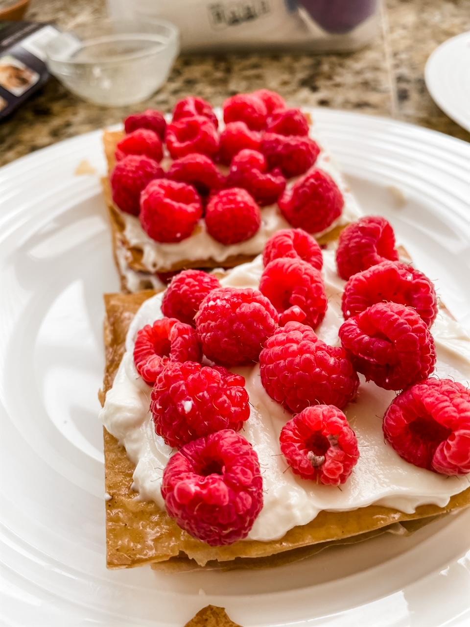 The pastries layered with yogurt and raspberries
