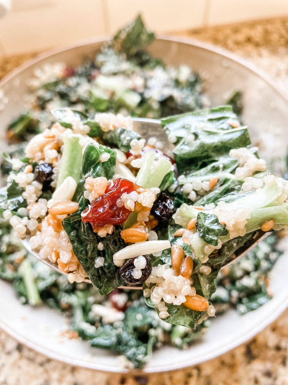 A forkful of the Superfood Salad Recipe held over a bowl