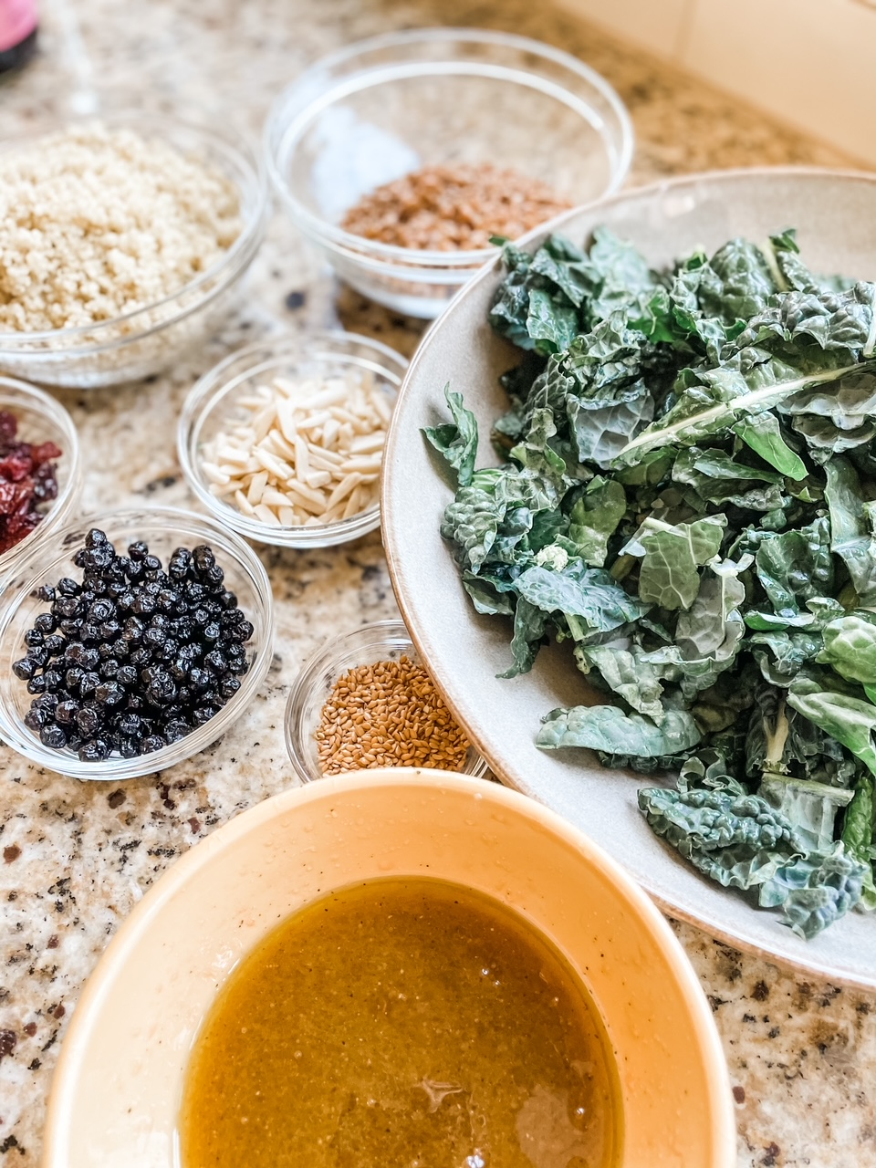The ingredients for the Superfood Salad Recipe laid out in individual bowls.