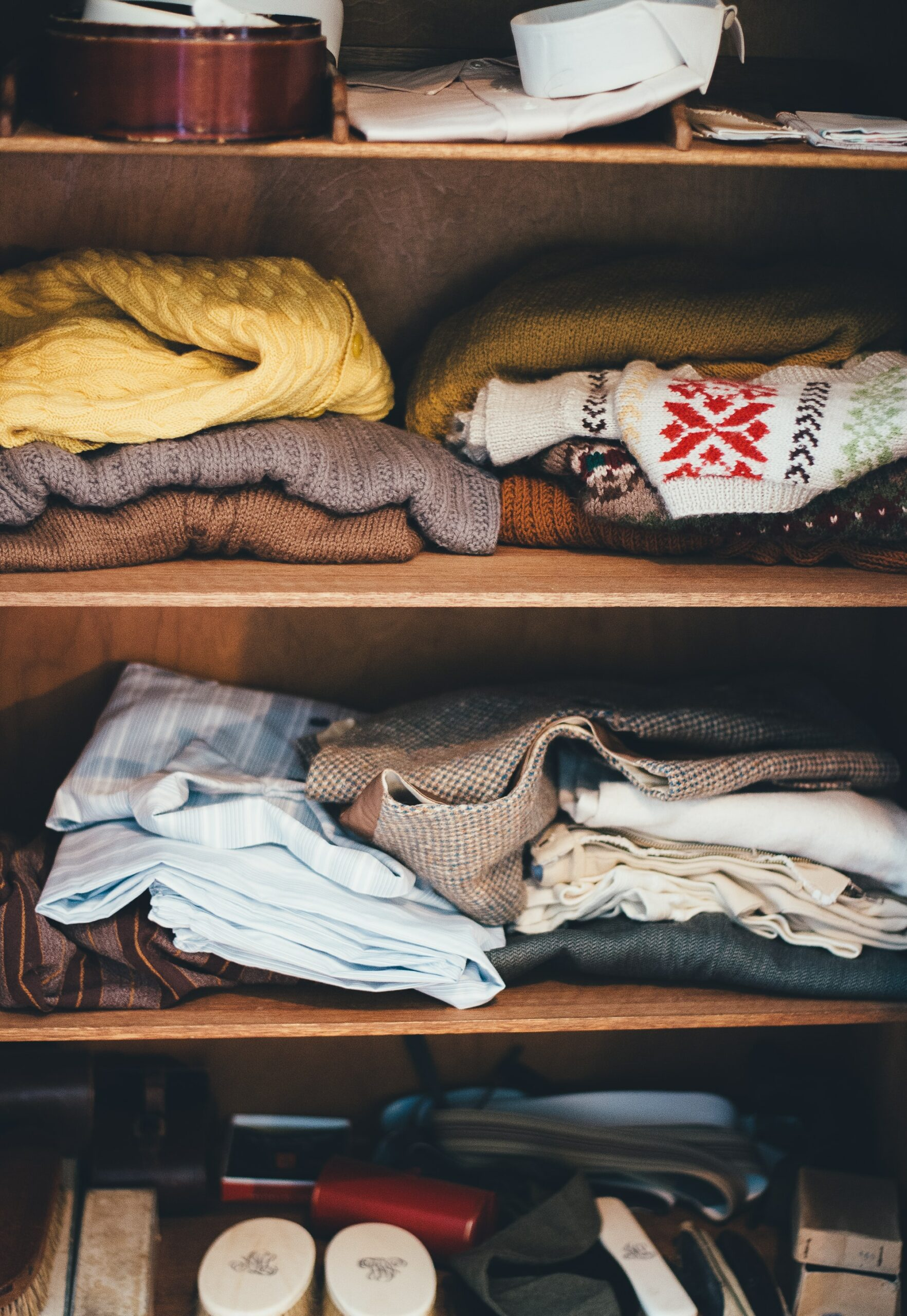 Work on one space at a time, such as this disorganized closet - a 10 Downsizing Tips and Truths