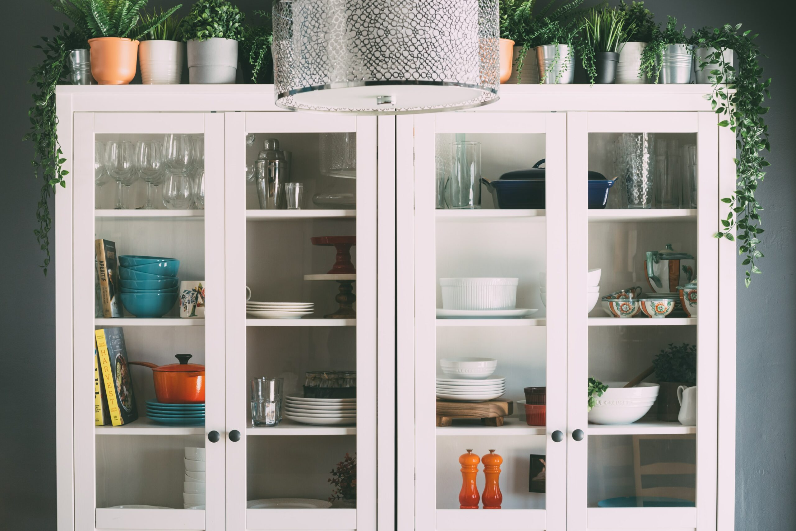 A cabinet full of dishware