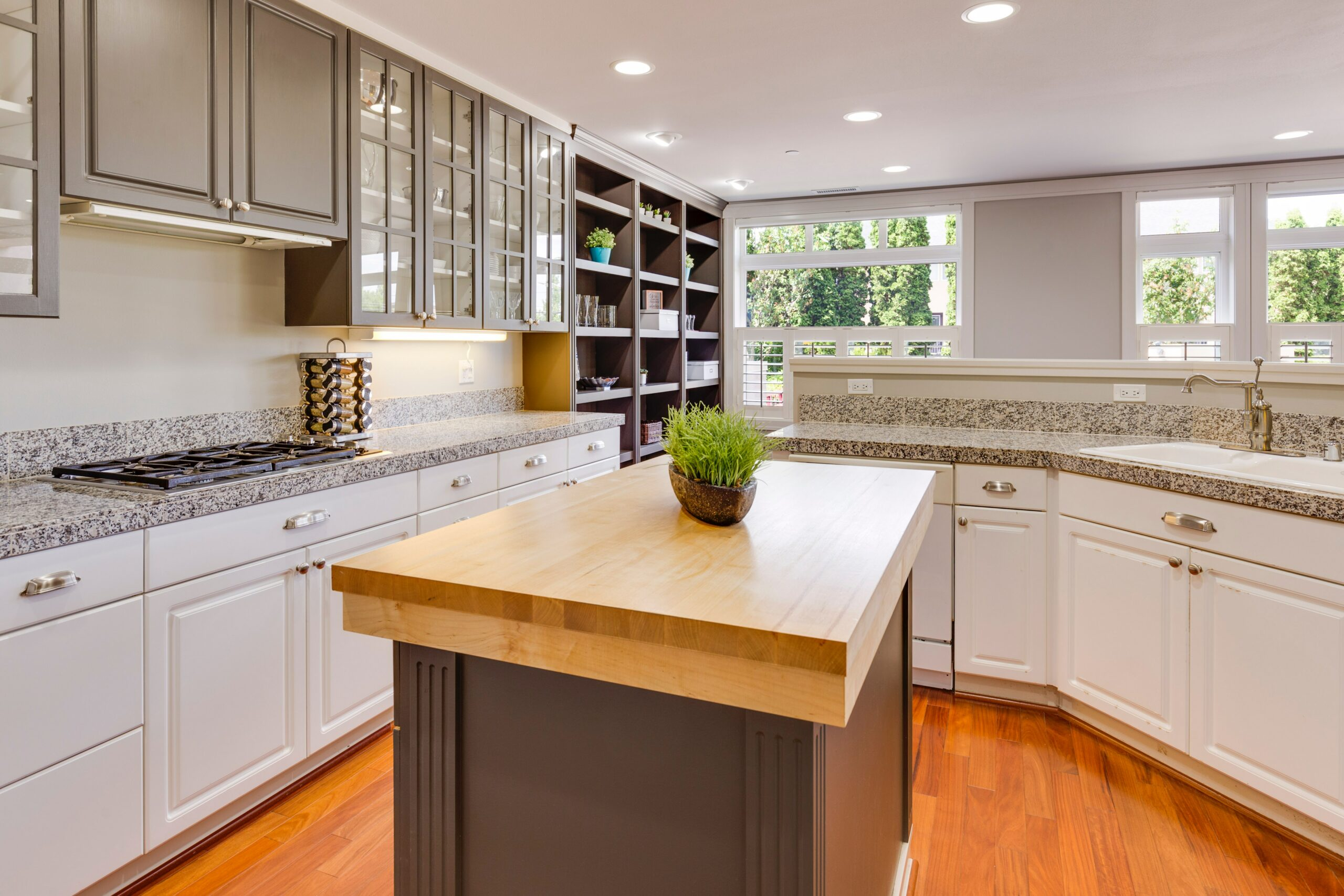 A kitchen with an island and plenty of counter space - cleared, clean counters