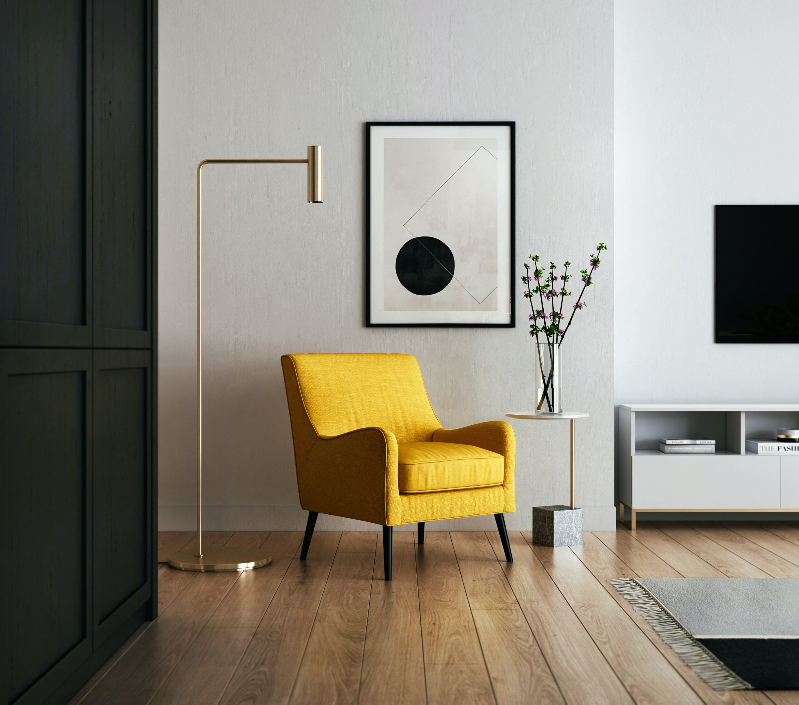 A pop of color in the form of a yellow chair in an otherwise neutral room - one of Marie's 10 Home Staging Tips