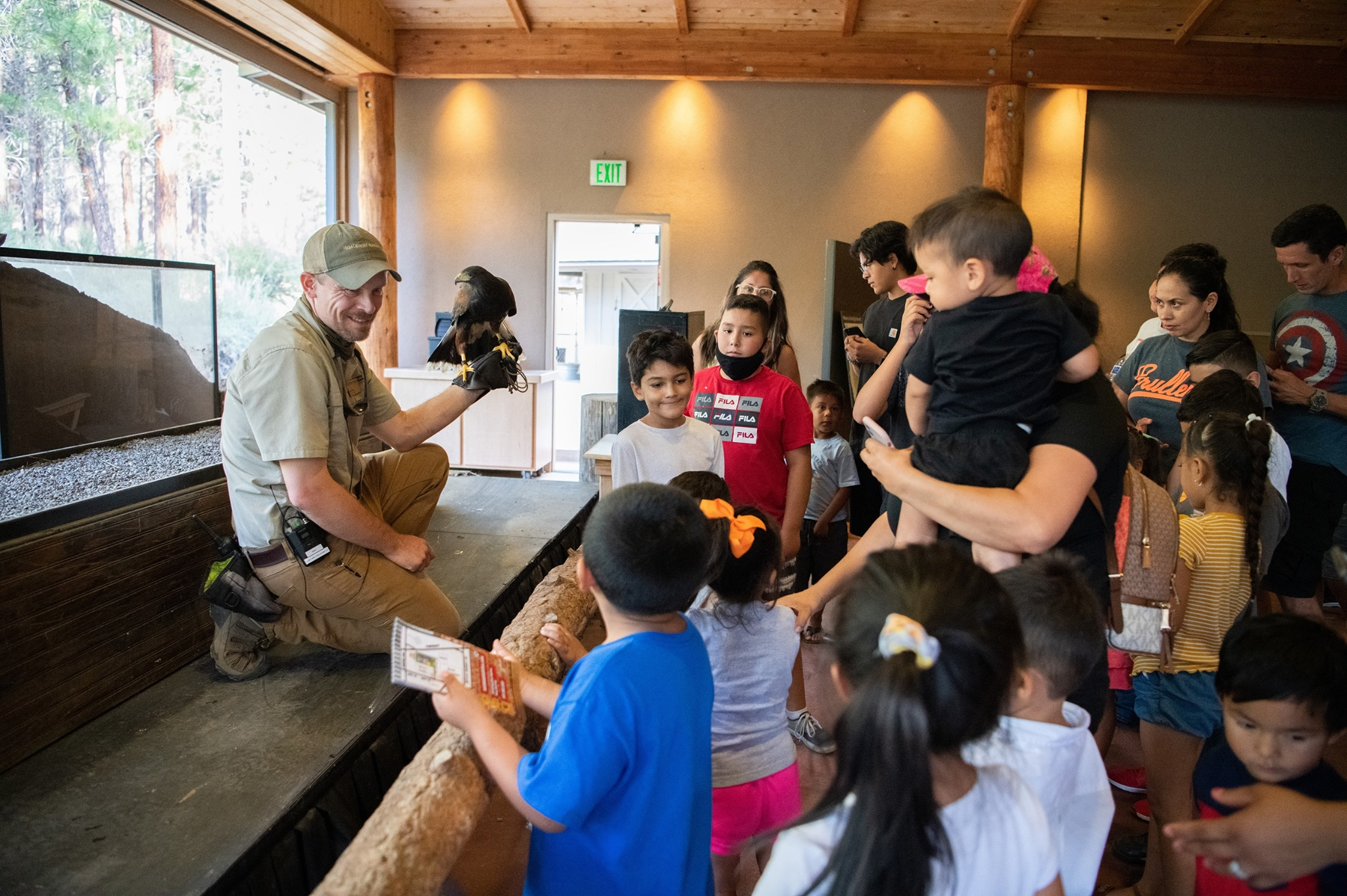 An image of a presentation at The High Desert Museum, attended by both kids and adults - one of the things to do in Bend, Oregon