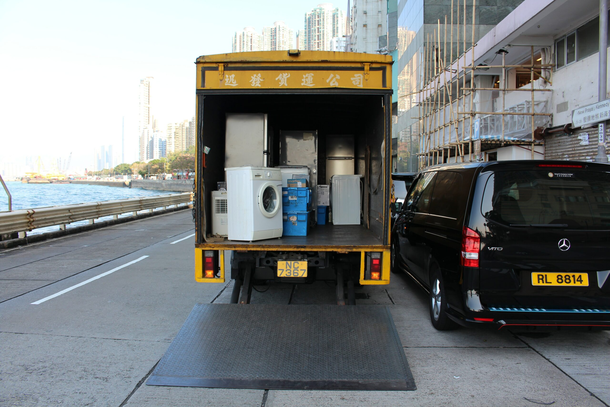 A full-service moving truck with items - including a washing machine - in it. One of the ways of moving out of state