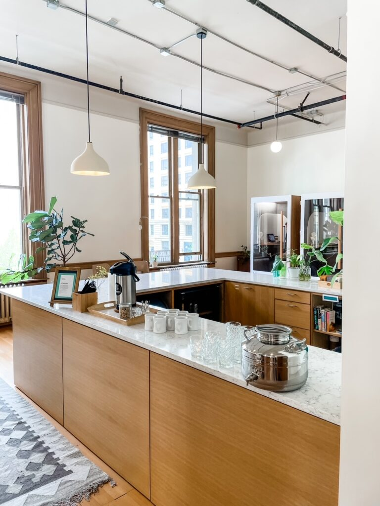 A kitchen and bar space available within Marie's coworking space