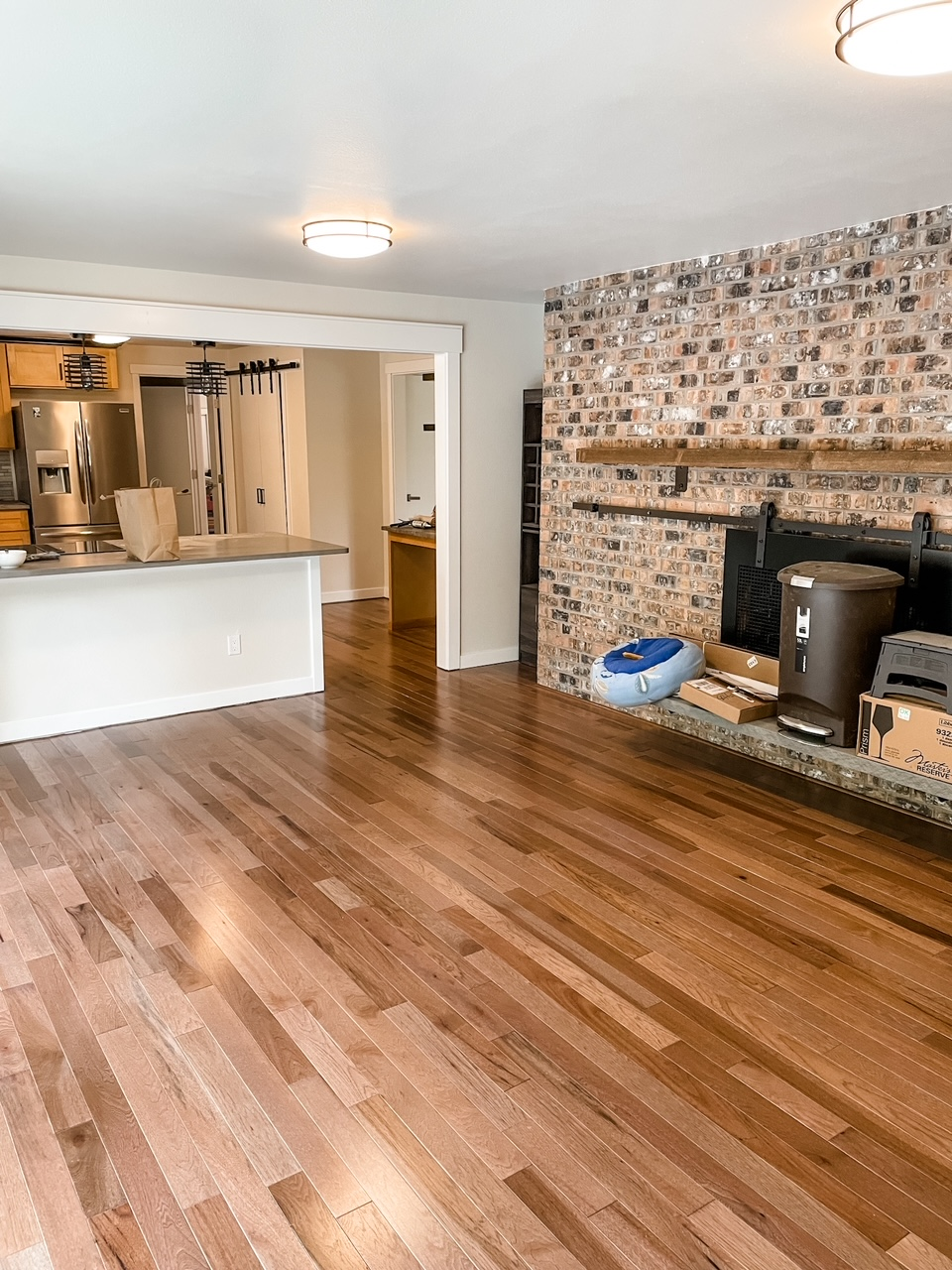 The after portion of the wooden flooring Remodeling Before and After - a warmer color of wood