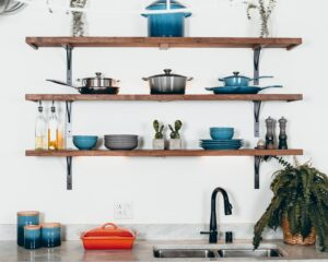 A wall full of kitchen tools and dishware