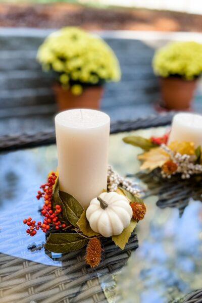 A DIY Fall Candle Wreath with a mini pumpkin