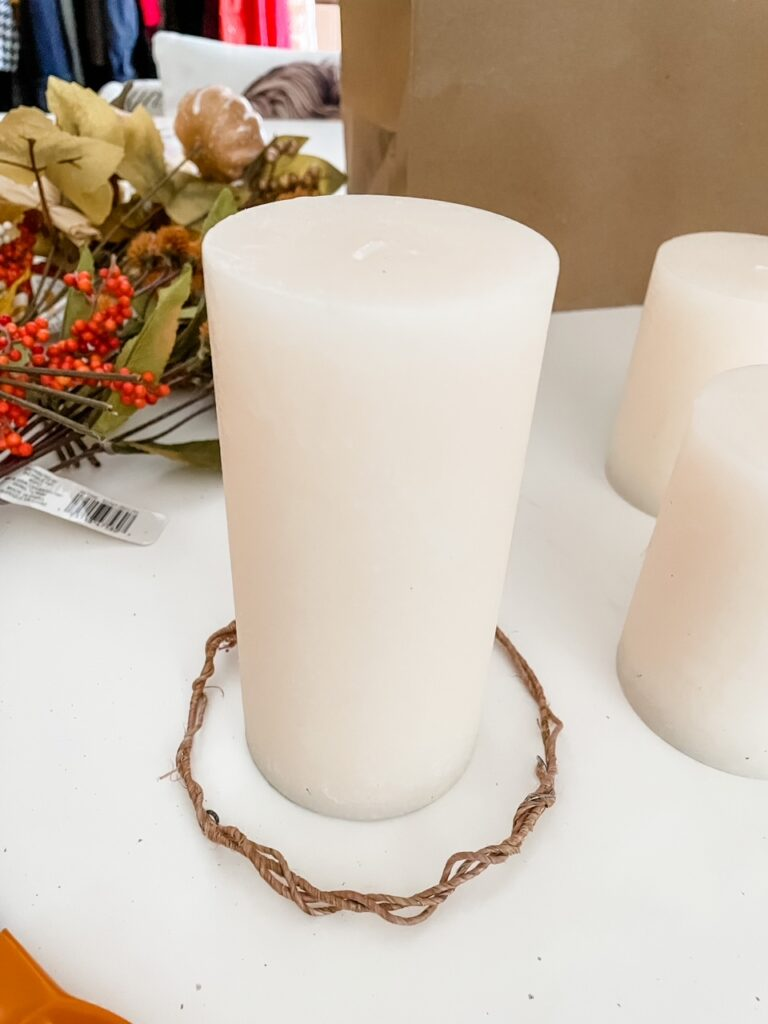 The hemp wire measured out to fit around the base of a pillar candle