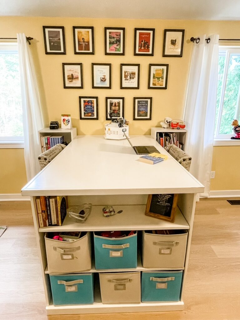 A close-up of my crafting table - with a gallery wall and storage cubes for easy access.
